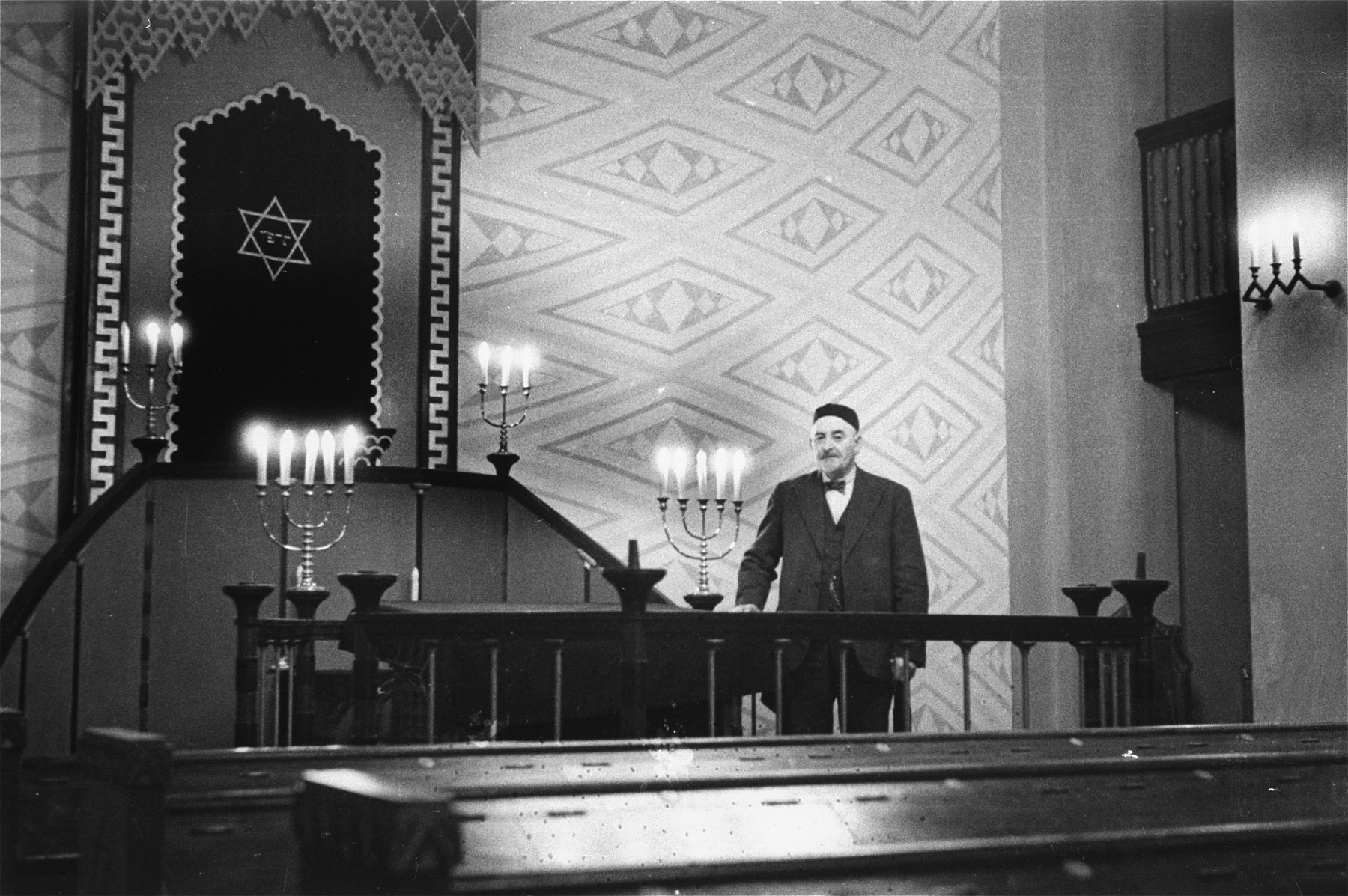 Portrait of Aron Mendelsohn, the donor's father, in the sanctuary of the synagogue in Trondheim, Norway.  Aron Mendelsohn was a clothing manufacturer in Trondheim, Norway, who was a prominent member of the local Jewish community.  He was later sent to the Falstad concentration camp.