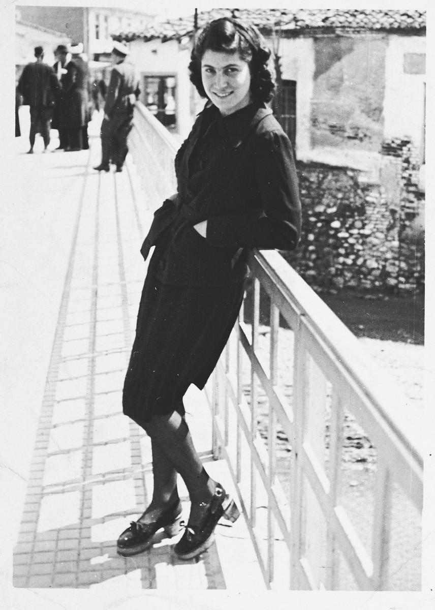 Portrait of a young Jewish woman leaning against a railing in Komotini, Greece.  Pictured is Nina Molina, a cousin of Salomon Saltiel, who later perished in Auschwitz.