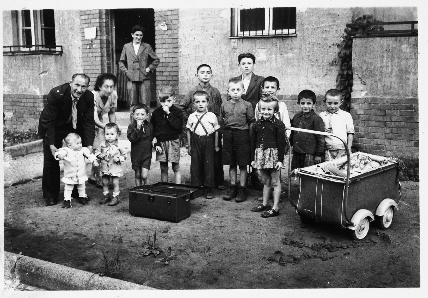 Jewish DP children pose outside a building in the Mariendorf displaced persons camp.