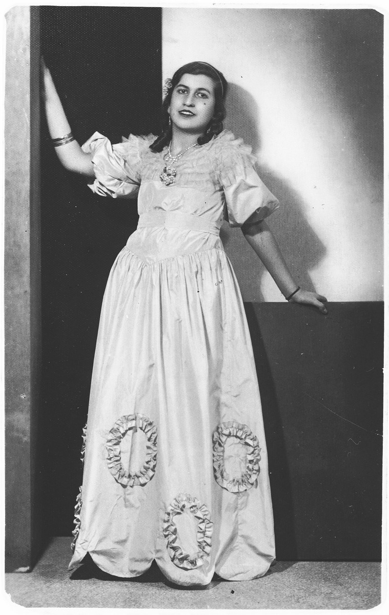 A young Jewish woman from Salonika poses in a ball gown.  Pictured is Aime Levy.
