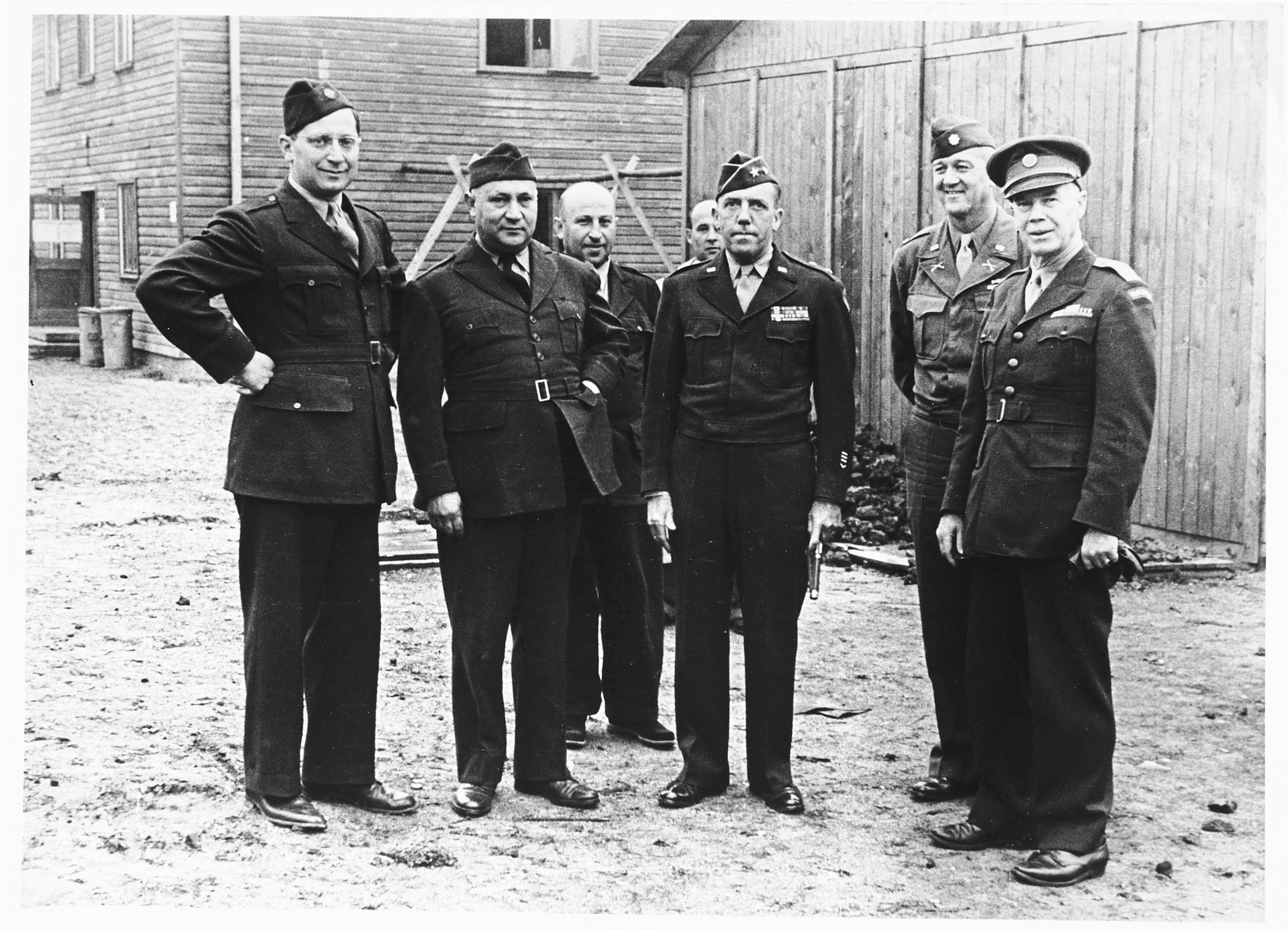 Group portrait of UNRRA personnel and American soldiers.  Among those pictured is Harold Fishbein, director of the Schlachtensee displaced persons camp, (second from the left).