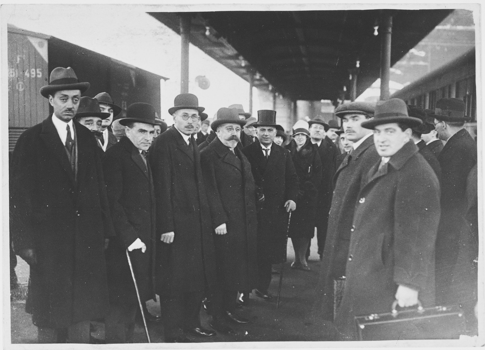 A delegation from the Soviet embassy waits at the train station in Rome to meet the new Soviet ambassador.  Among those pictured are Samuel and Sophia Pevsner.  Samuel defected shortly thereafter.