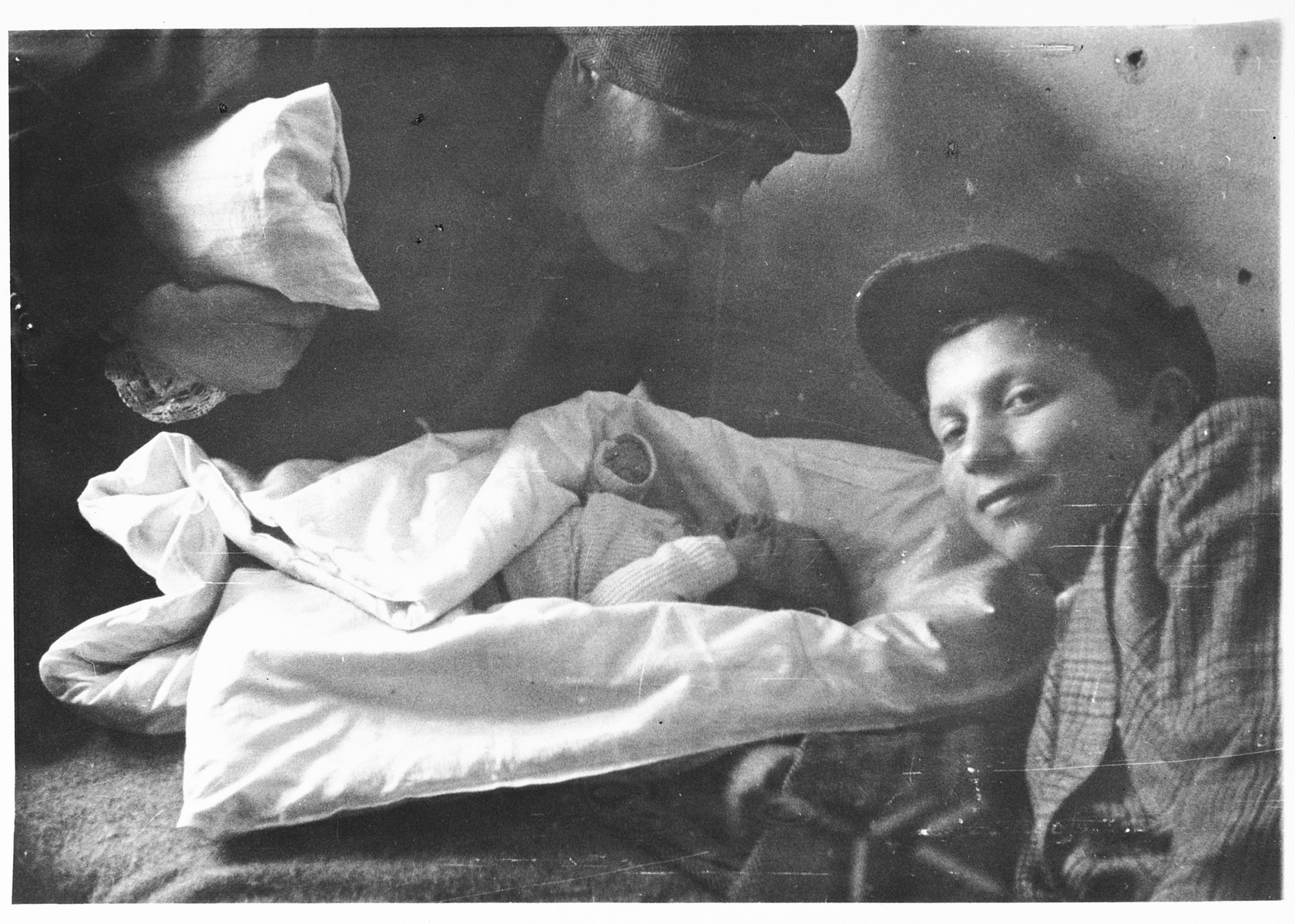 Jewish DPs attend a newborn baby in the Schlachtensee displaced persons camp.