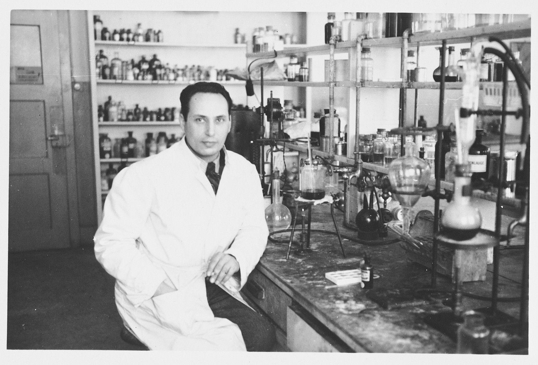 Edmund Dresner, a Jewish refugee, works in a chemical laboratory after escaping to Switzerland.