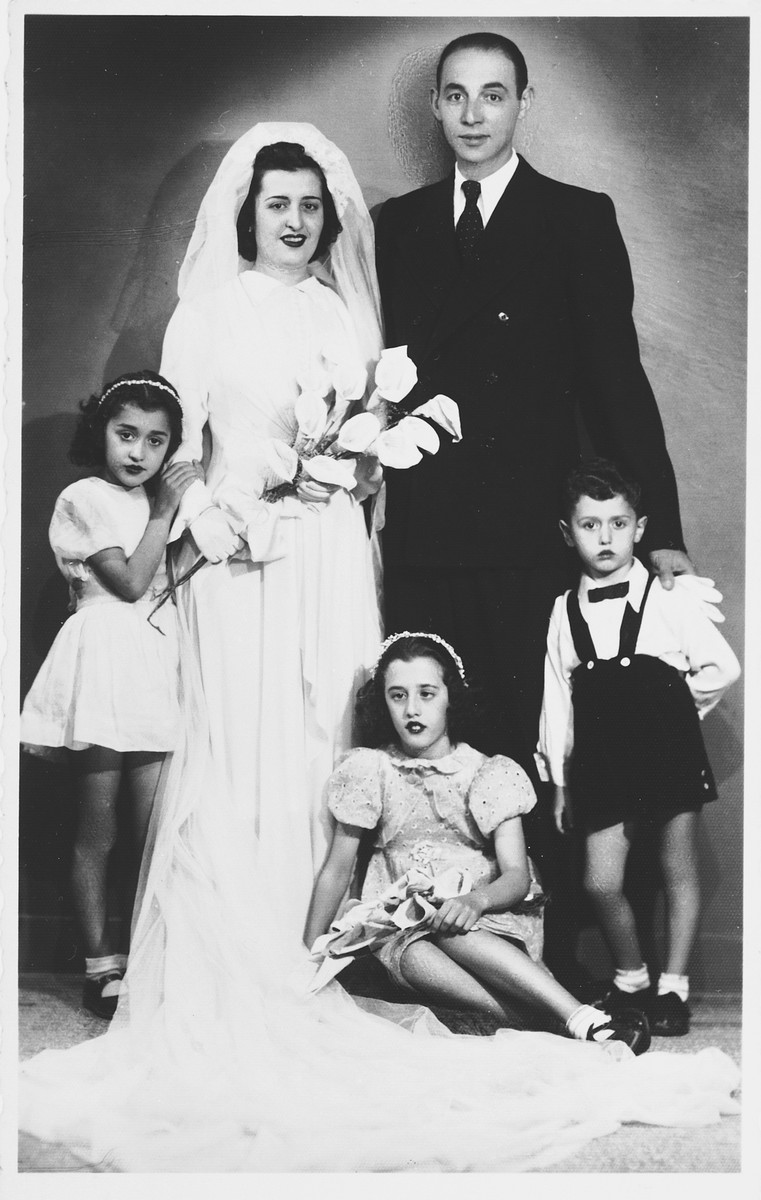 Wedding portrait of a Jewish couple in Salonika.  Pictured are Rachel Aroueste and Jacob Cohen.  The three children, whose last name was Natzari, were the nieces and nephew of the bride.  All of those pictured perished during the Holocaust.  Rachel's mother, Rikoutsa Aroueste, was the older sister of Salomon Levy.