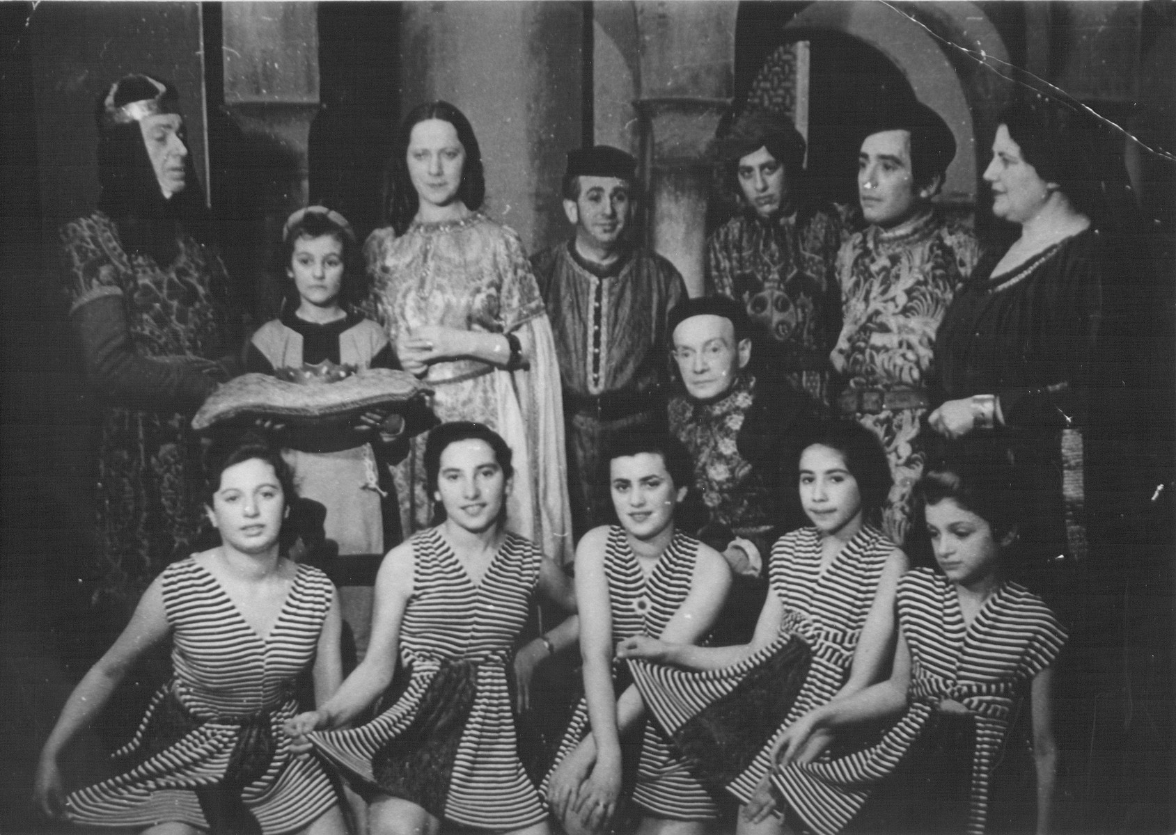 Group portrait of Jewish DPs celebrating Purim at the Wittenau displaced persons camp in the French zone of Berlin.