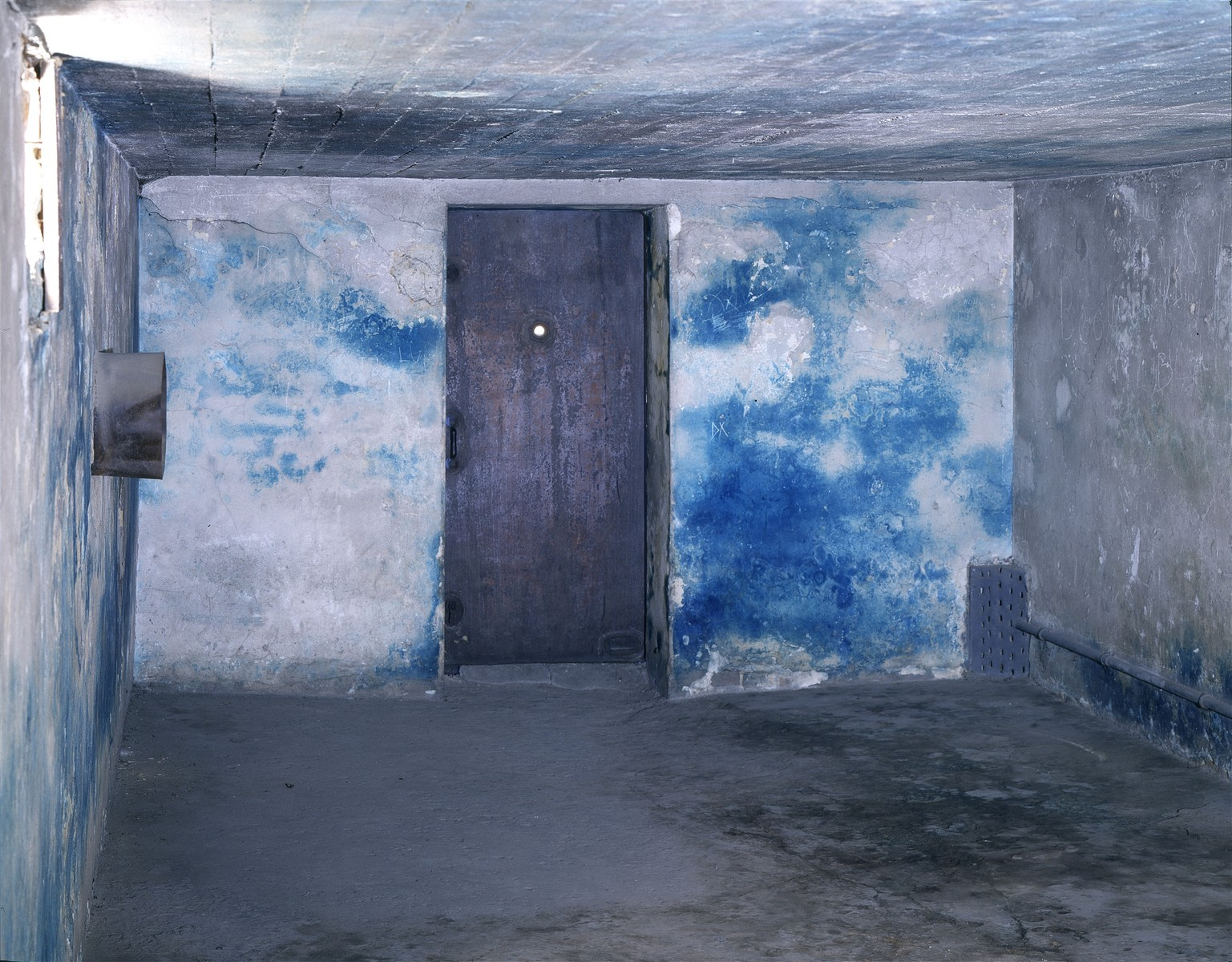 Interior view of a gas chamber at Majdanek (post-liberation).  The blue stain is from the Zyklon B.