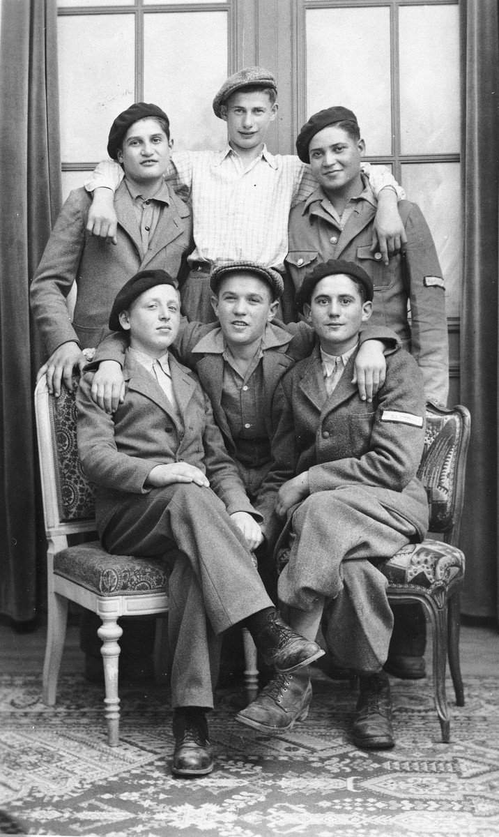Group portrait of Jewish DP youth who numbered among the Buchenwald children, at an OSE (Oeuvre de Secours aux Enfants) children's home in France [either in Ambloy or Taverny].