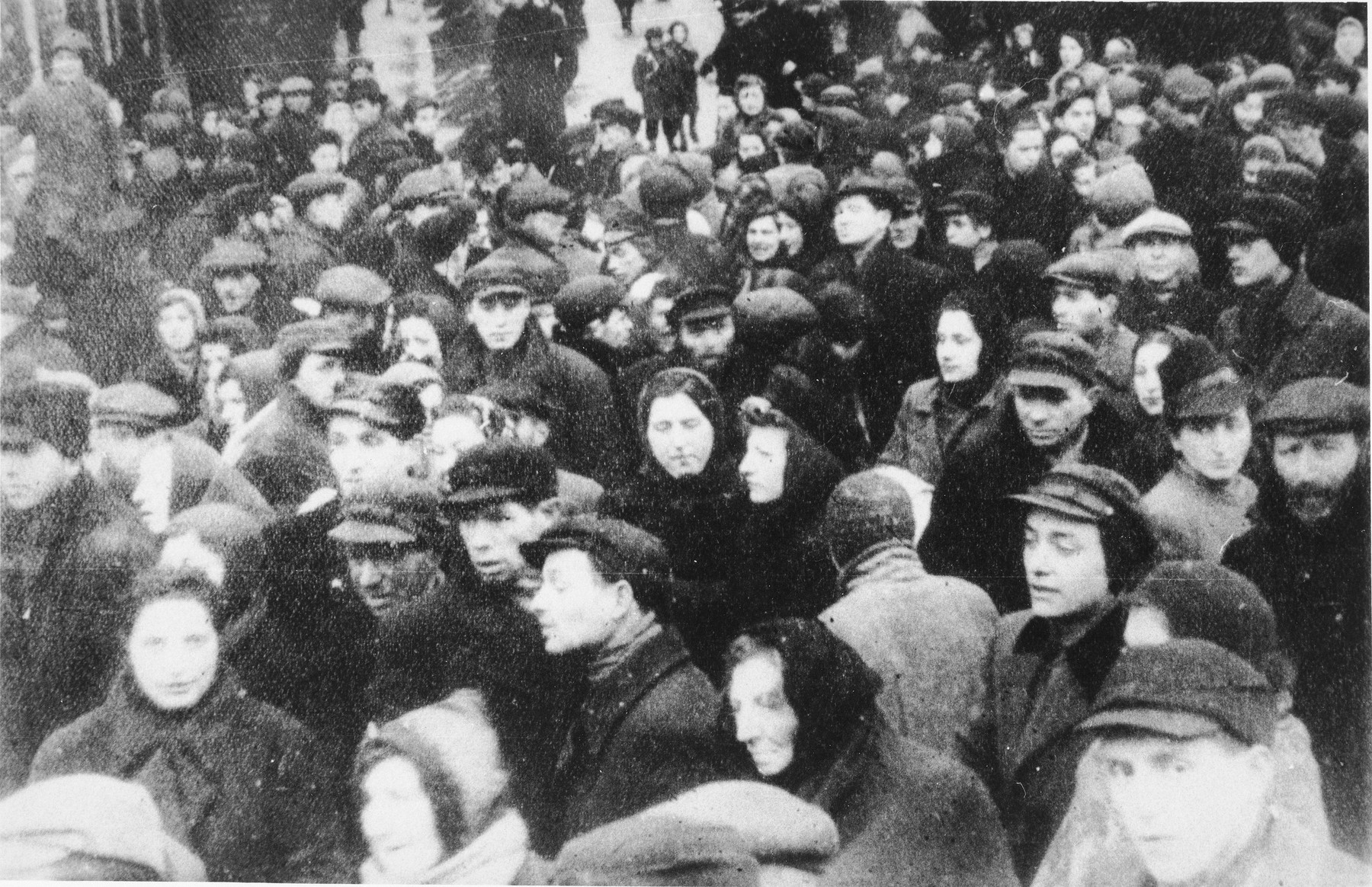 Jewish residents are crowded in a public square of an unidentified ghetto.