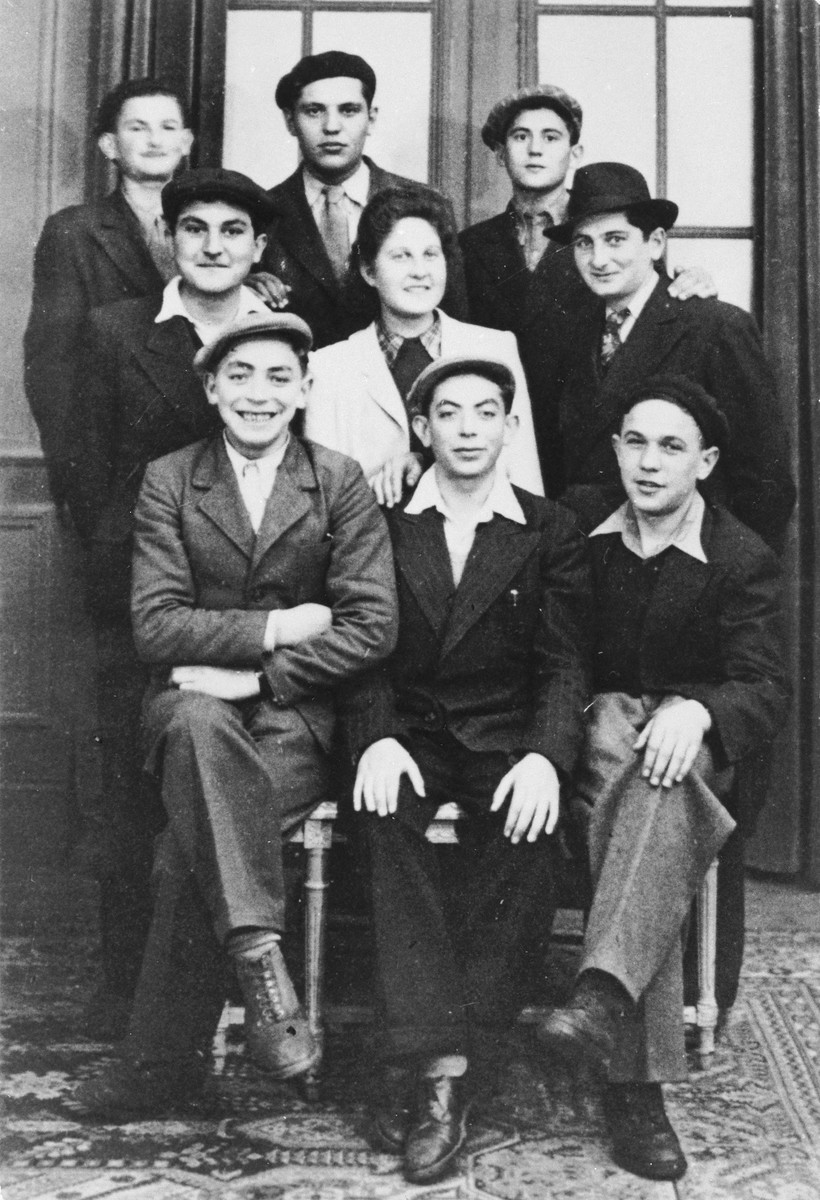 Judith Hemmendinger poses with a group of Jewish DP youth who numbered among the Buchenwald children, at an OSE (Oeuvre de Secours aux Enfants) children's home in France [either in Ambloy or Taverny].