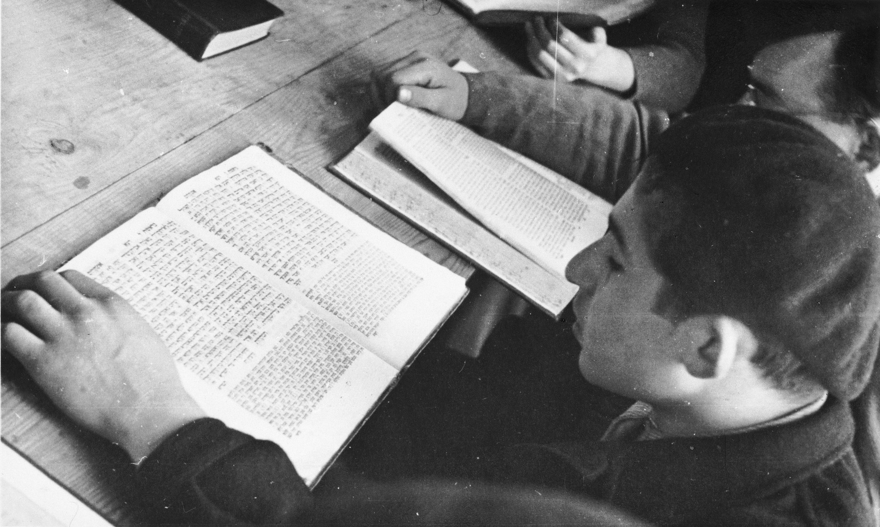 Jewish DP youth who numbered among the Buchenwald children, study religious texts at an OSE (Oeuvre de Secours aux Enfants) children's home in France [either in Ambloy or Taverny].