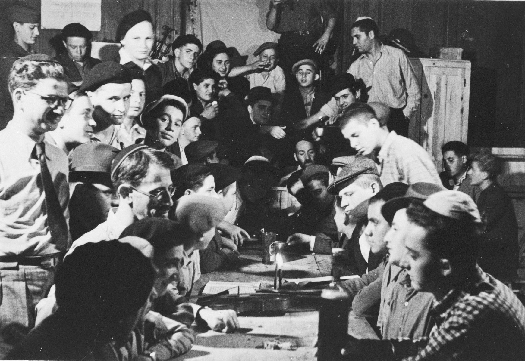 Jewish DP youth who numbered among the Buchenwald children, are gathered around a table at an OSE (Oeuvre de Secours aux Enfants) children's home in France [either in Ambloy or Taverny].