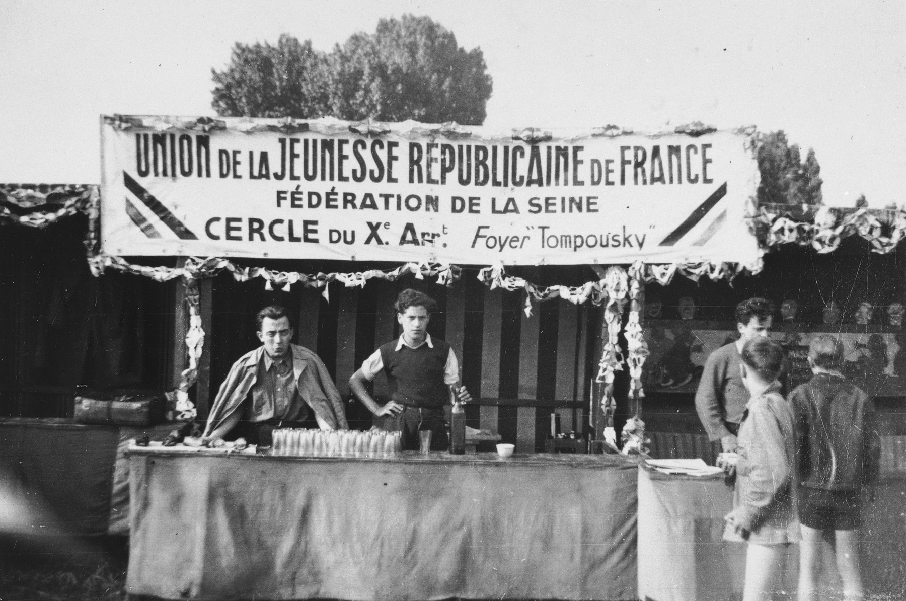 Benno Ginsburg helps man a booth at a gathering of the Union of Young Republicans of France, an umbrella organization of socialist and communist youth movements, including left-wing Zionists.