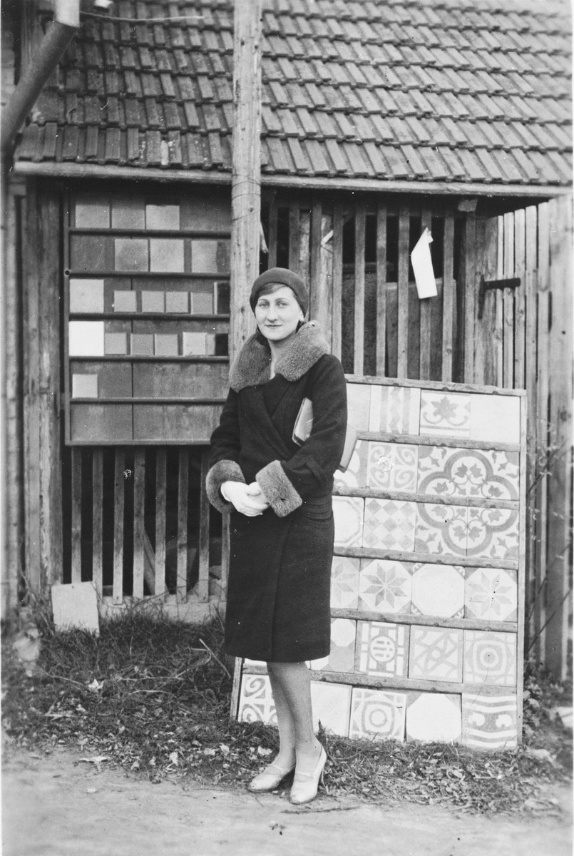Iby Kalman poses in front of a display of tiles at the Kalman's building supply business in Kalocsa, Hungary.