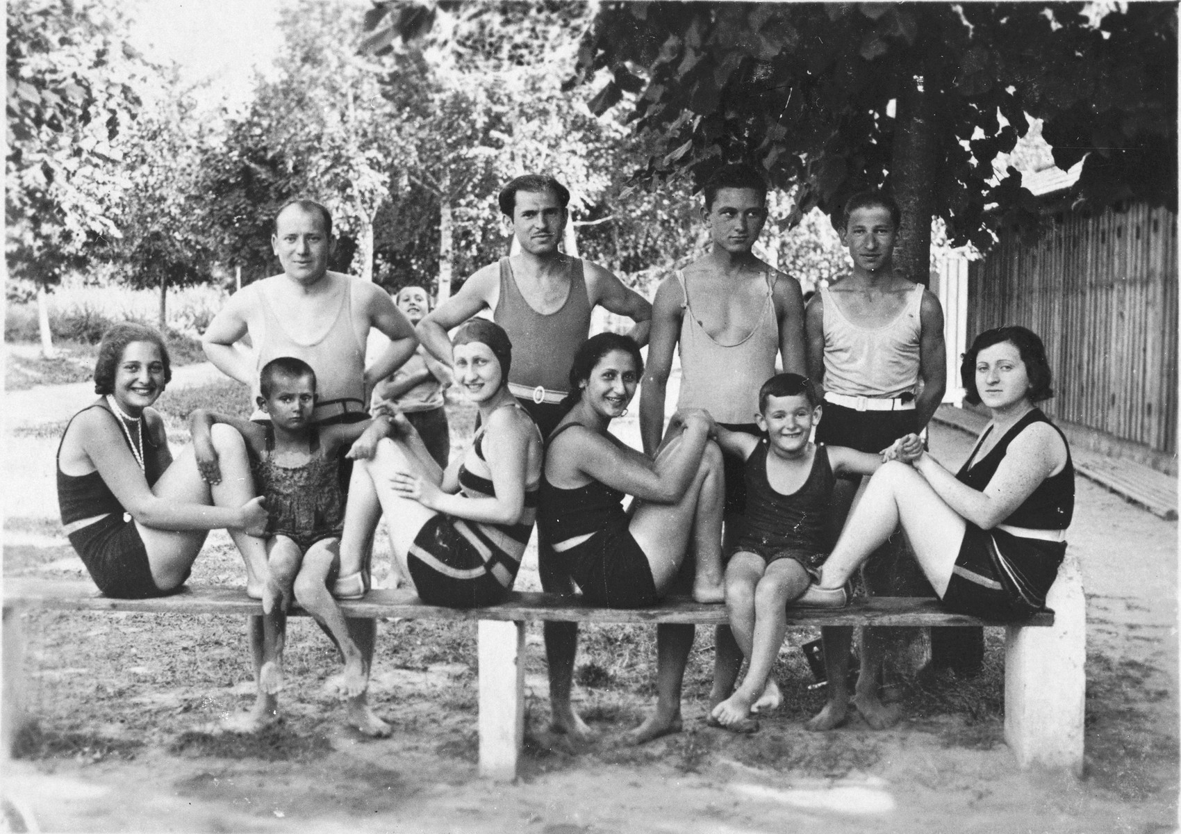Group portrait of Jewish friends wearing bathing suits at a swimming pool in Kalocsa, Hungary.