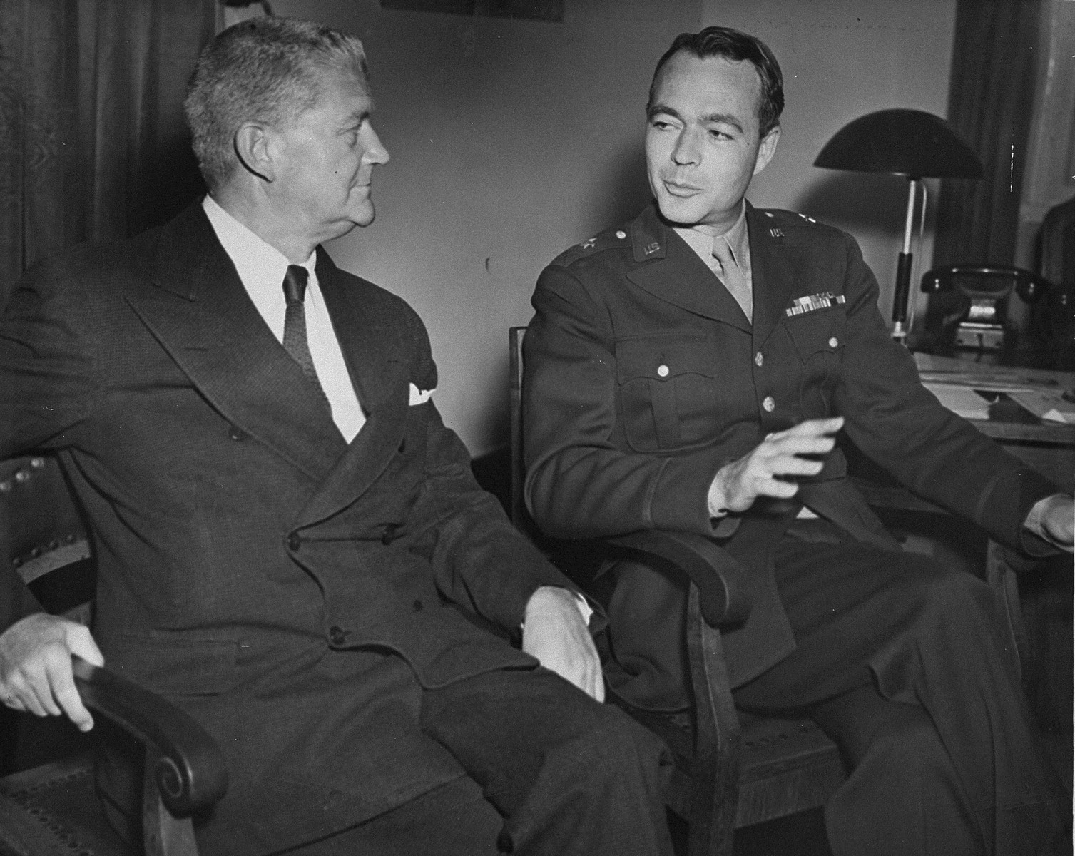 Associate U.S. trial counsel Brigadier General Telford Taylor (right) with an unidentified man at the International Military Tribunal trial of war criminals at Nuremberg.