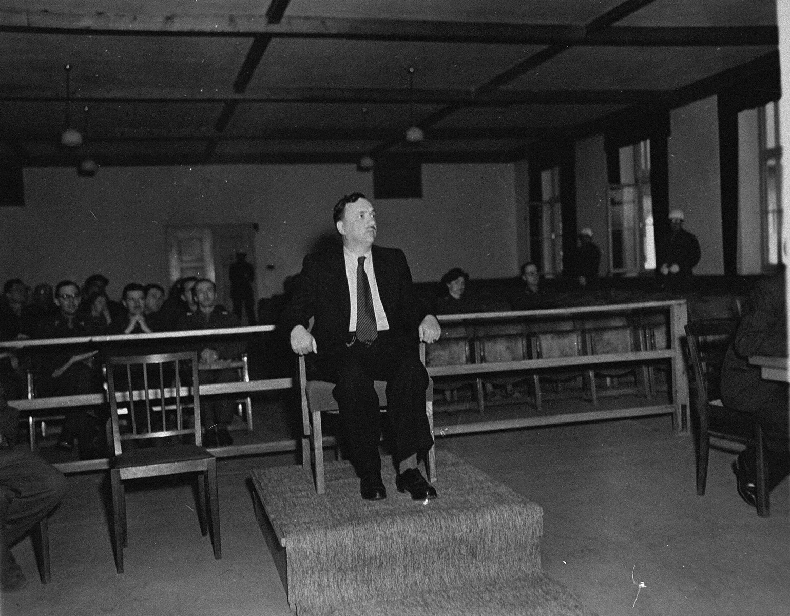 A witness testifies at the trial of 61 former camp personnel and prisoners from Mauthausen.