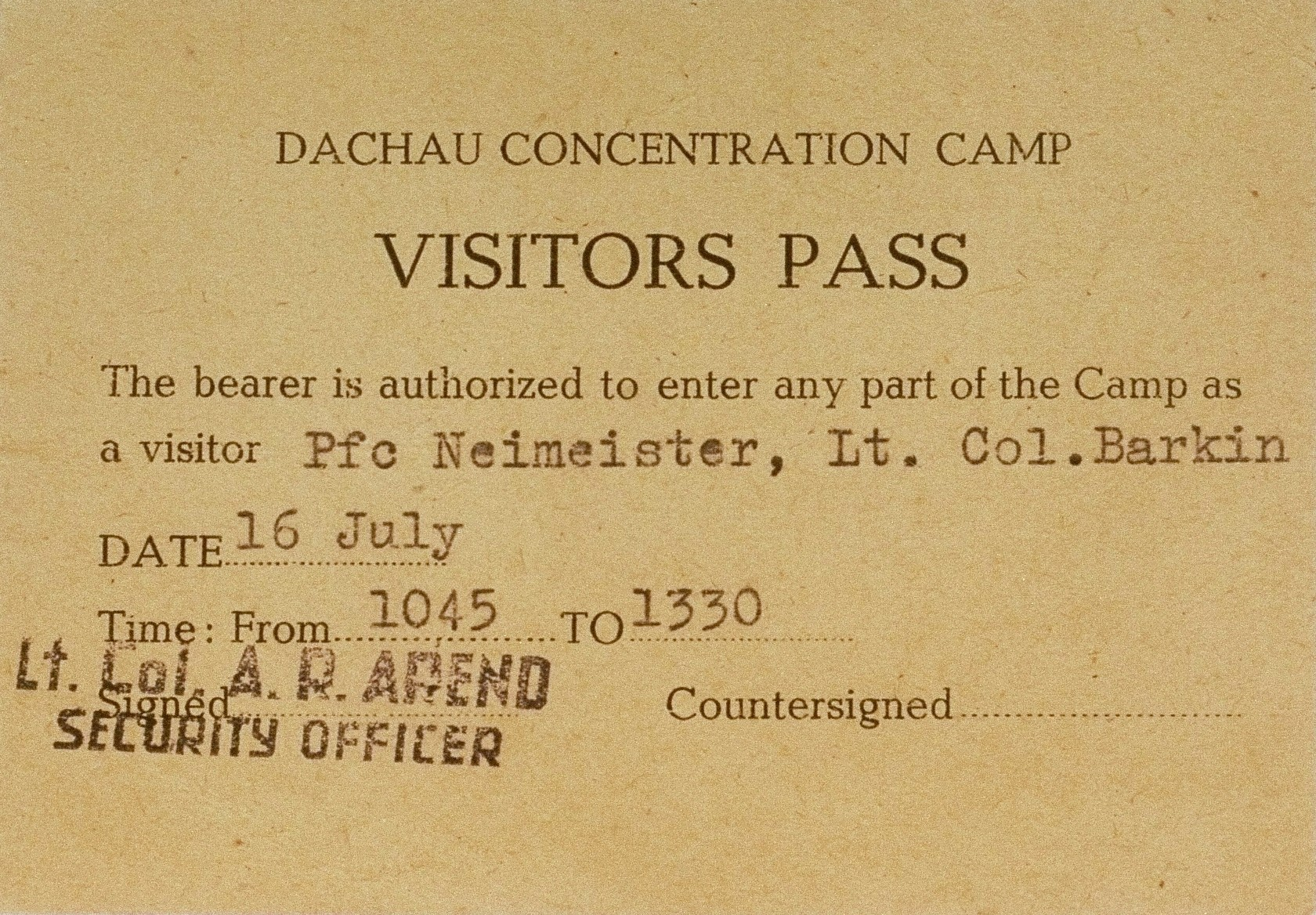 A one day visitor's pass to the military court in Dachau to view the trial of 61 former camp personnel and prisoners from Mauthausen, used by Pfc. Neimeister and Lt. Col. Albert Barkin.