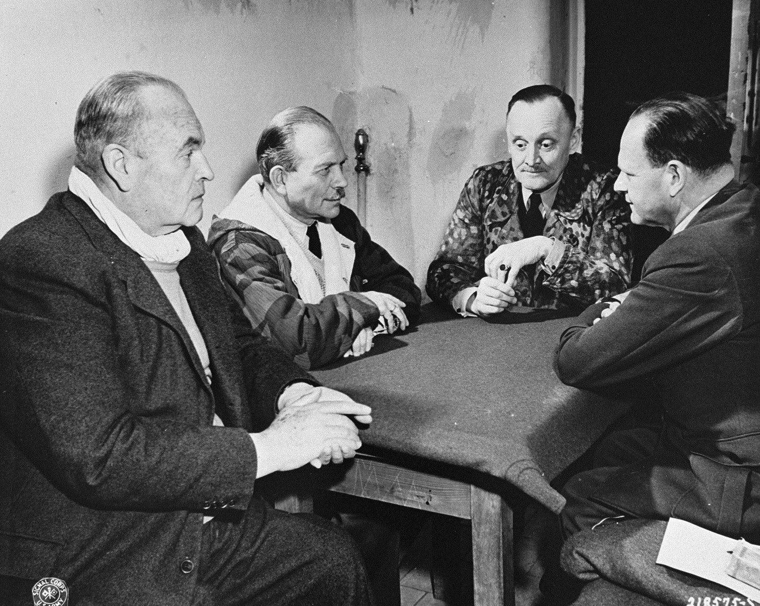 Former Luftflotte Commander Hugo Sperrle, former Chief of General Staff Heinz Guderian, former Air Force General Hans Jurgen Stumpff, and former Air Force Field Marshall Erhard Milch play cards until they are called to be witnesses at the International Military Tribunal trial of war criminals at Nuremberg.