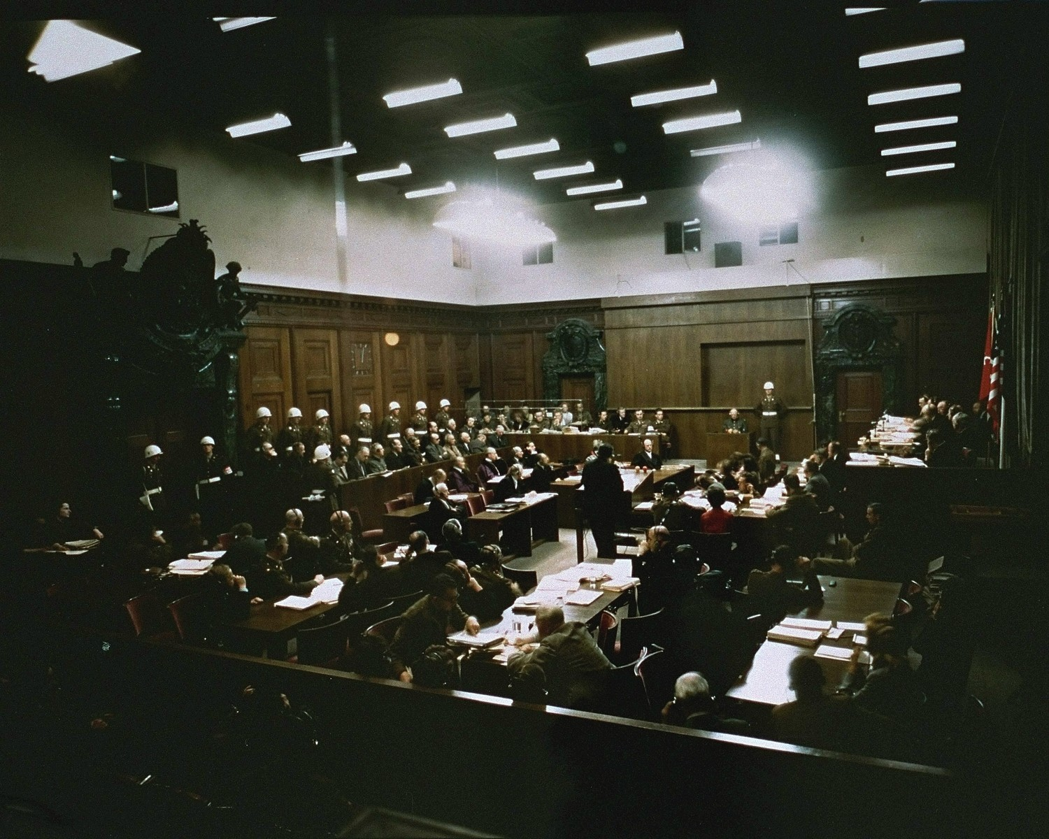 Lawyers for the prosecution (bottom), the defendants (left), and the International Military Tribunal (right), at the trial of war criminals at Nuremberg.