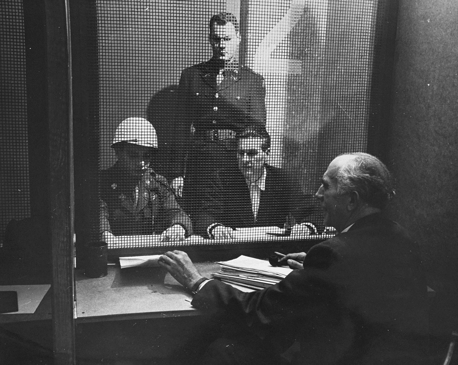 Defendant Baldur von Schirach speaks with his lawyer, Dr. Fritz Sauter, in prison during the International Military Tribunal trial of war criminals at Nuremberg.
