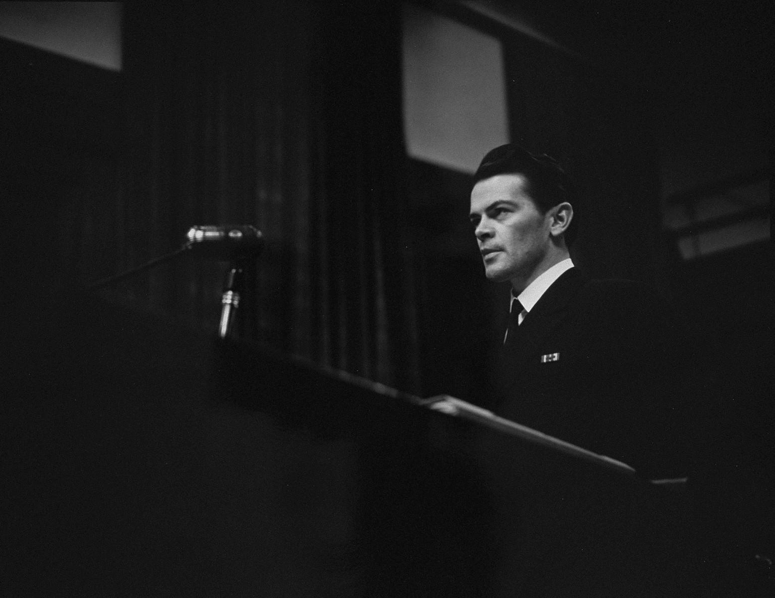 U.S. Assistant trial counsel Lt. Thomas F. Lambert, Jr. presents the prosecution's case against Martin Bormann at the International Military Tribunal for war criminals at Nuremberg.