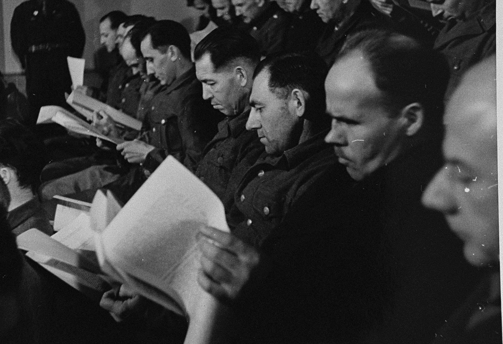 The defendants receive the indictment against them at the trial of 61 former camp personnel and prisoners from Mauthausen.