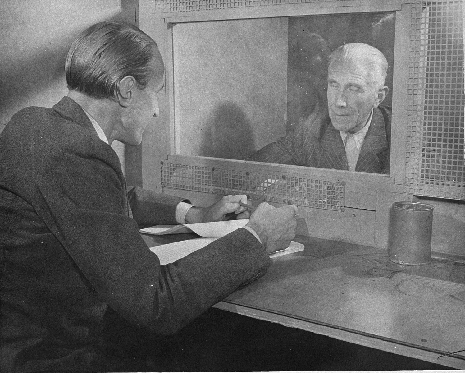 Defendant Franz von Papen receives a visit from his son while in prison at the International Military Tribunal trial of war criminals at Nuremberg.
