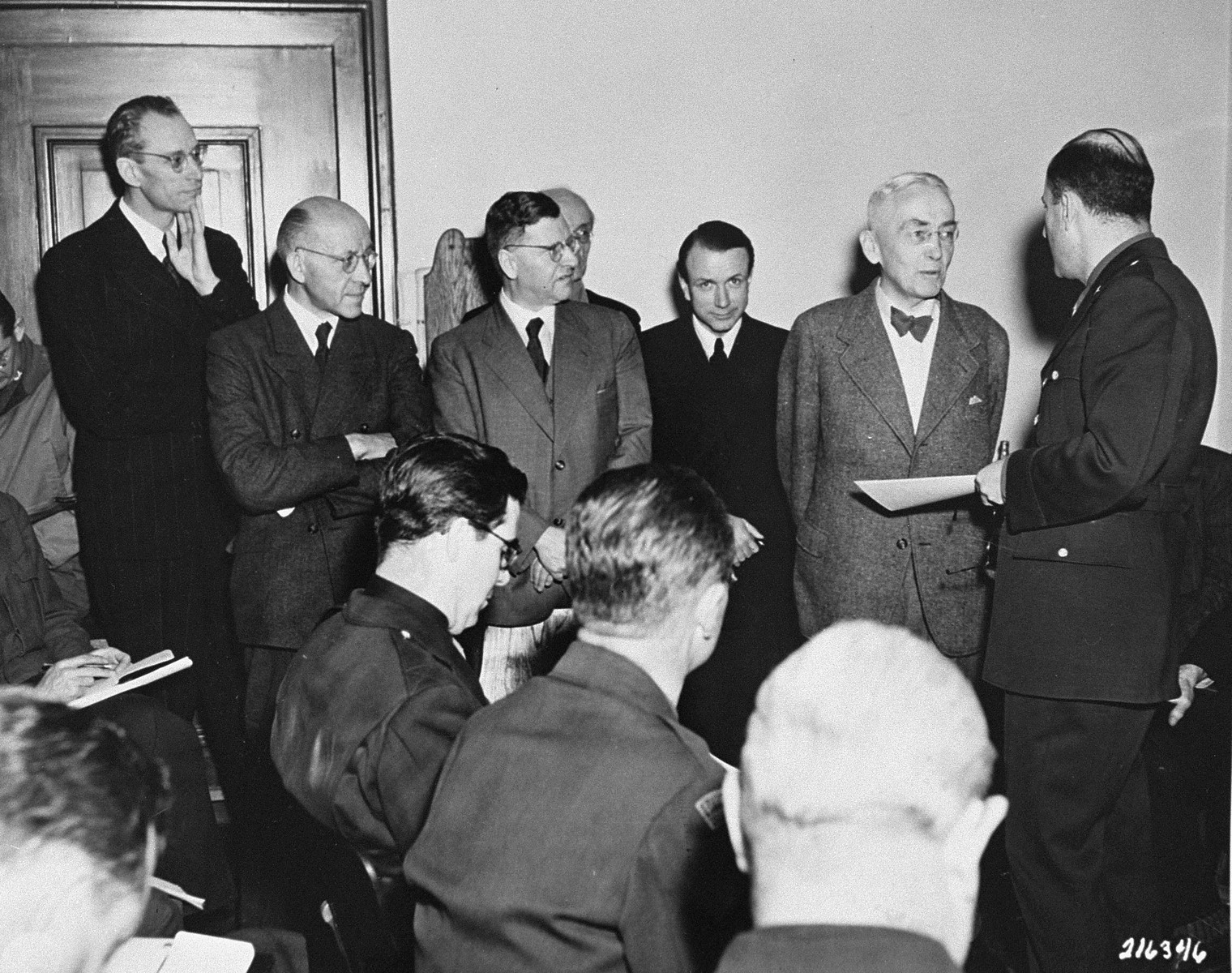 Defense attorney Dr. Otto Stahmer, the counsel for Hermann Goering, is introduced to a roomful of news correspondents before the beginning of the International Military Tribunal trial of war criminals at Nuremberg.