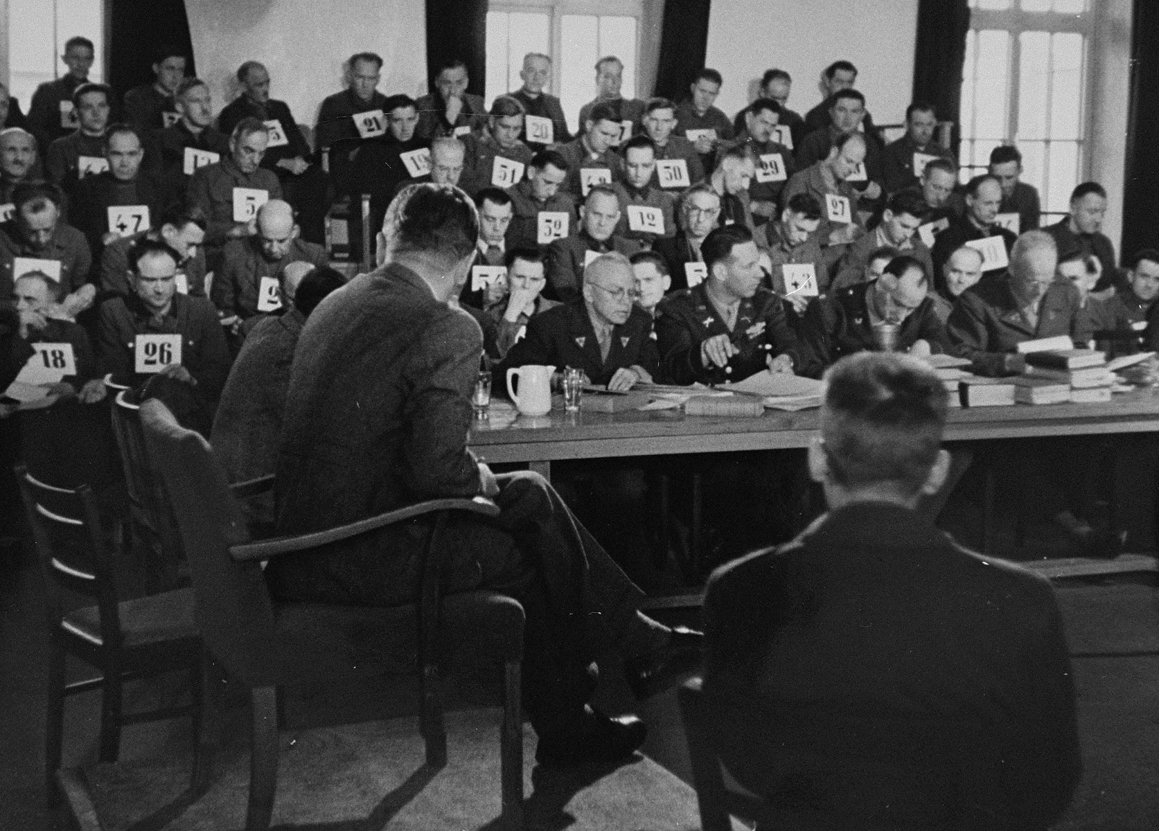 A witness testifies for the prosecution at the trial of 61 former camp personnel and prisoners from Mauthausen.