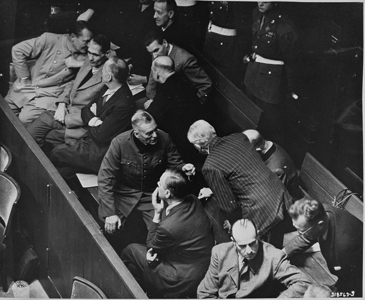 The defendants confer during a recess at the International Military Tribunal trial of war criminals at Nuremberg.