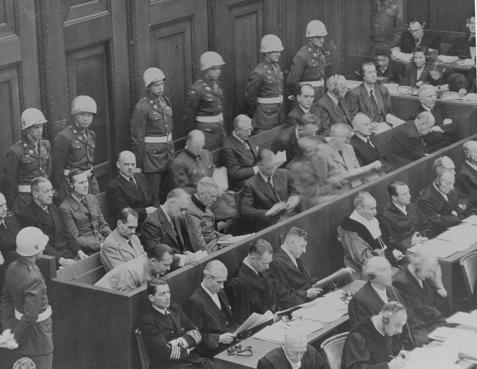 The defendants and their lawyers hear the reading of an indictment on the first day of the International Military Tribunal of war criminals at Nuremberg.