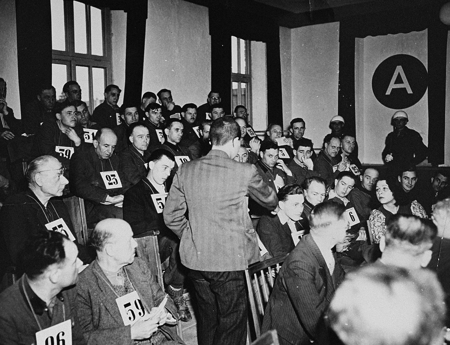 A witness identifies a defendant at the trial of 61 former camp personnel and prisoners from Mauthausen.