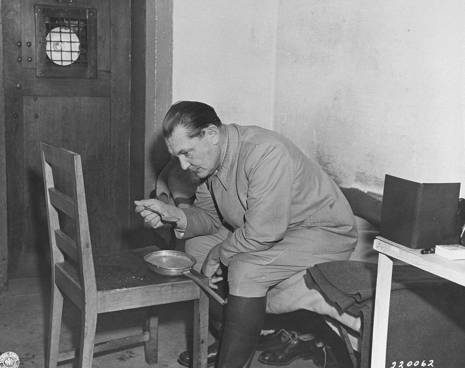 Hermann Goering eats breakfast in his cell while awaiting the opening of the day's court proceedings at the International Military Tribunal trial of war criminals at Nuremberg.