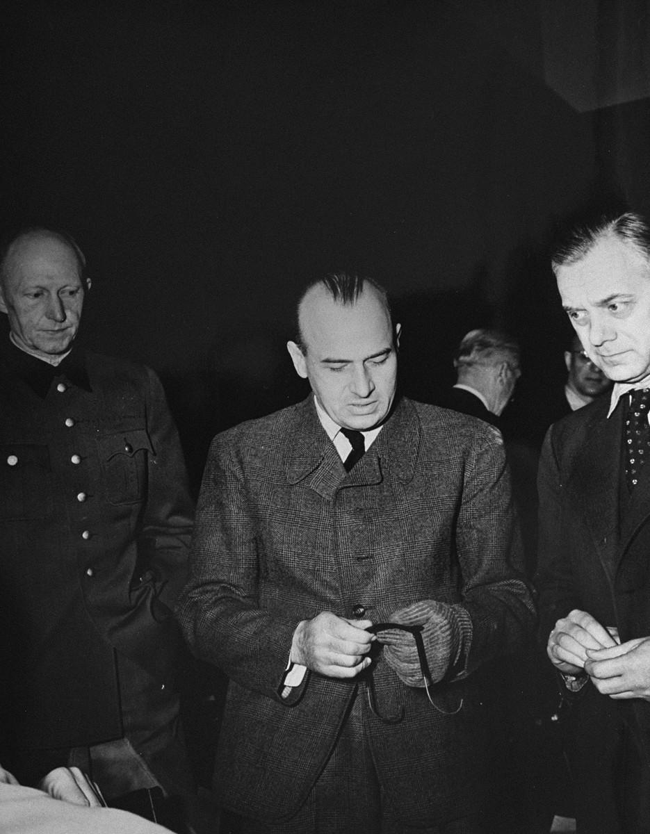 Defendants Alfred Jodl, Hans Frank, and Alfred Rosenberg during a recess at the International Military Tribunal trial of war criminals at Nuremberg.