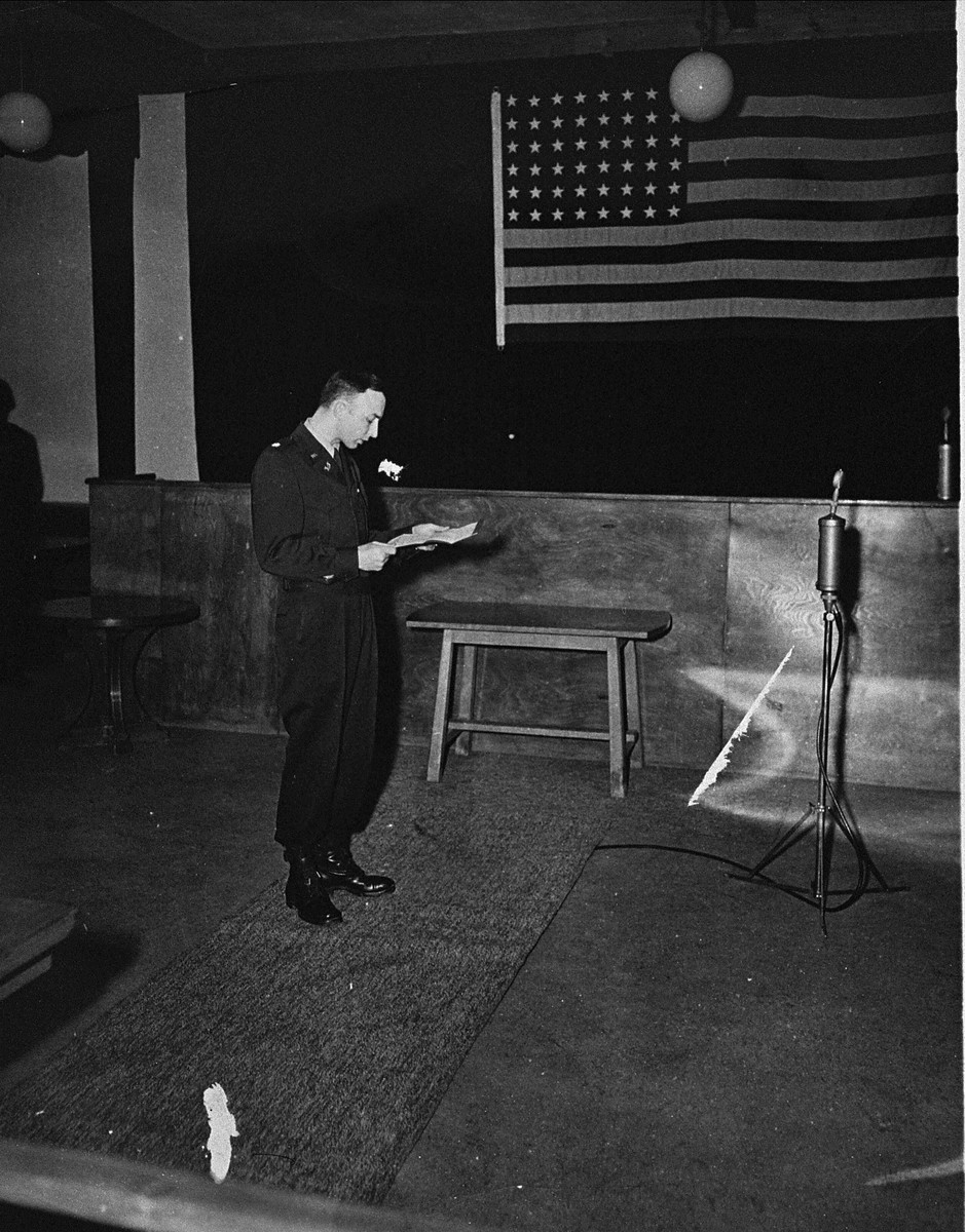 U.S. prosecutor William Denson reads over the indictment at the trial of 61 former camp personnel and prisoners from Mauthausen.