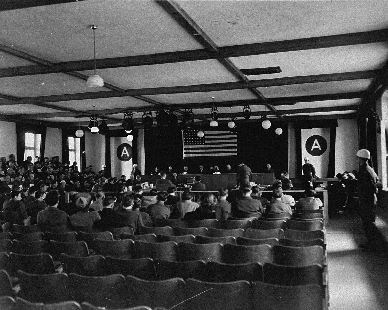 The American Military Tribunal hears the testimony of a witness at the trial of 61 former camp personnel and prisoners from Mauthausen.