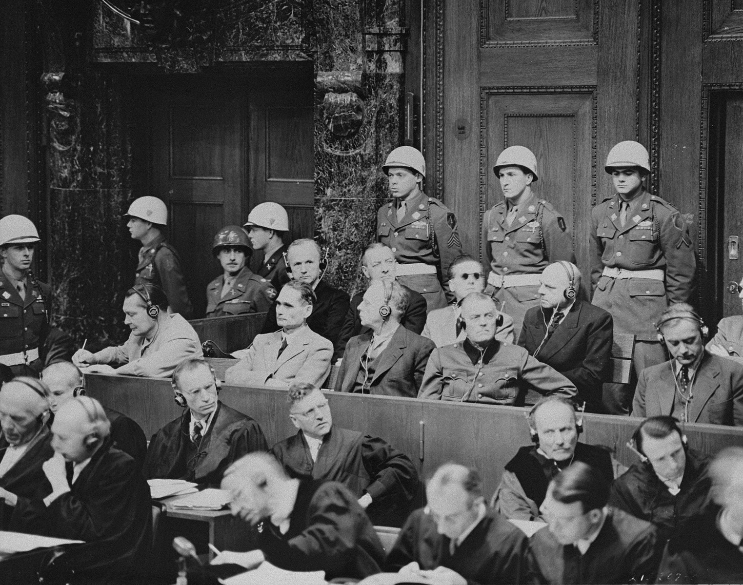 The defendants listen as the prosecution begins introducing documents at the International Military Tribunal for war criminals at Nuremberg.