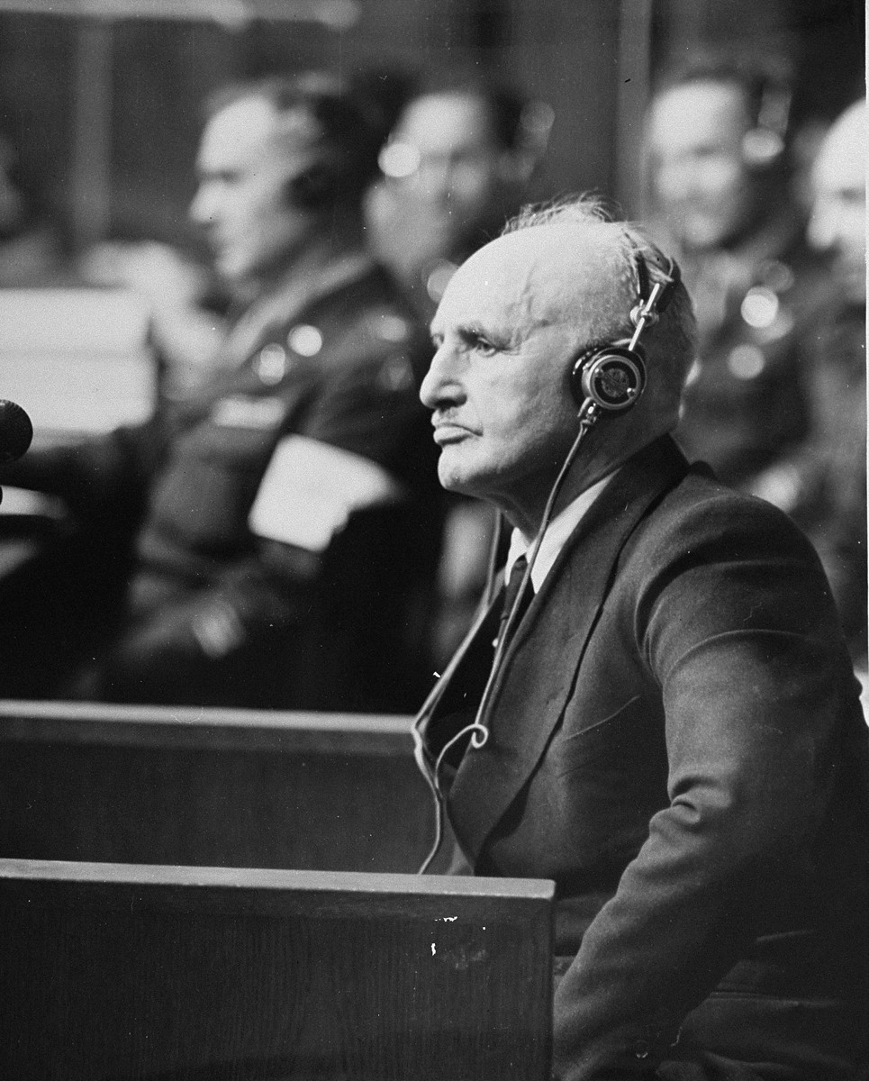 "Defendant Julius Streicher, the former editor of ""Der Stuermer,"" on the stand at the International Military Tribunal trial of war criminals at Nuremberg."