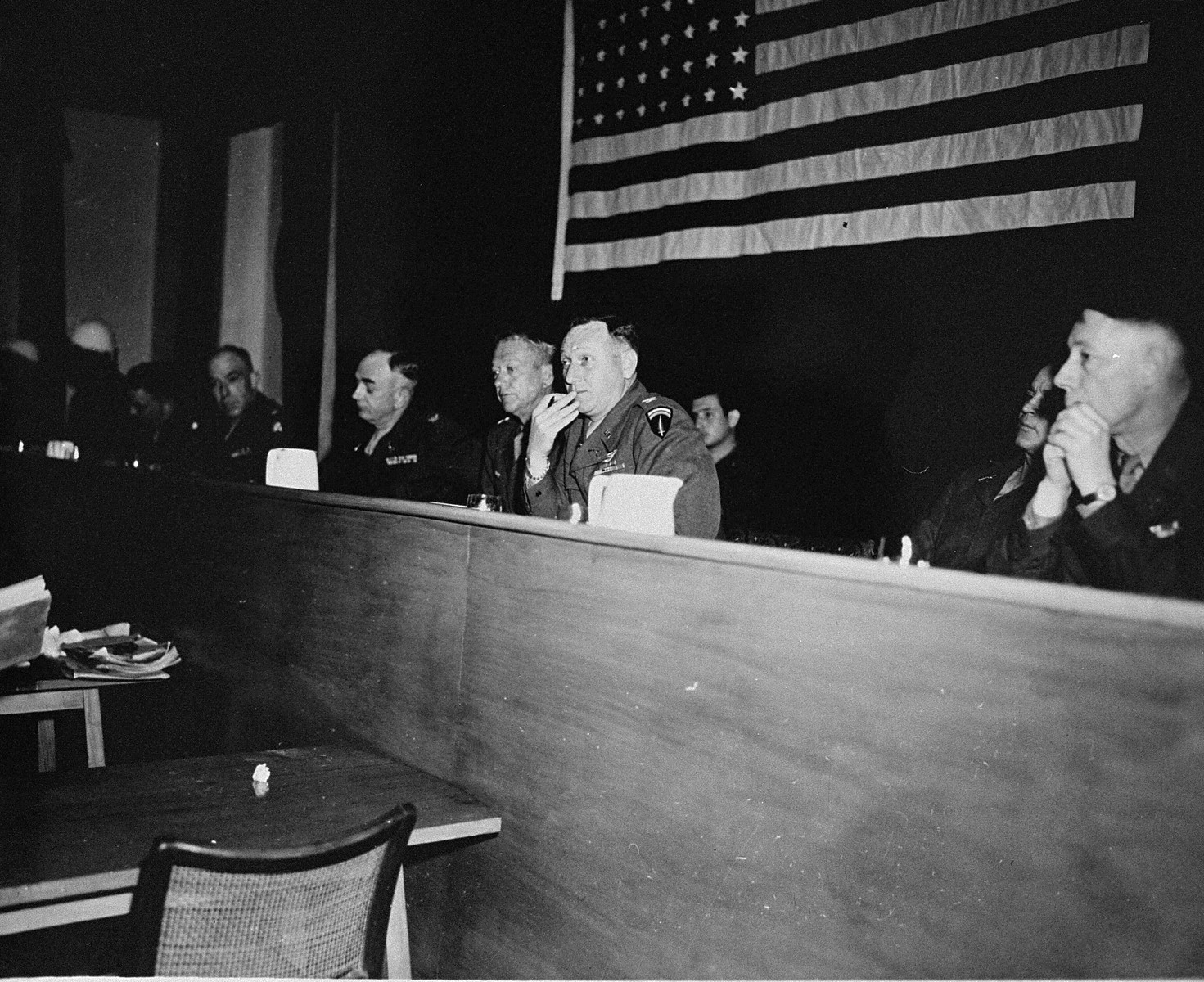 The American Military Tribunal hearing the trial of 61 former camp personnel and prisoners from Mauthausen.  Fourth from the left is the Tribunal's president, Major General Fay Brink Prickett.