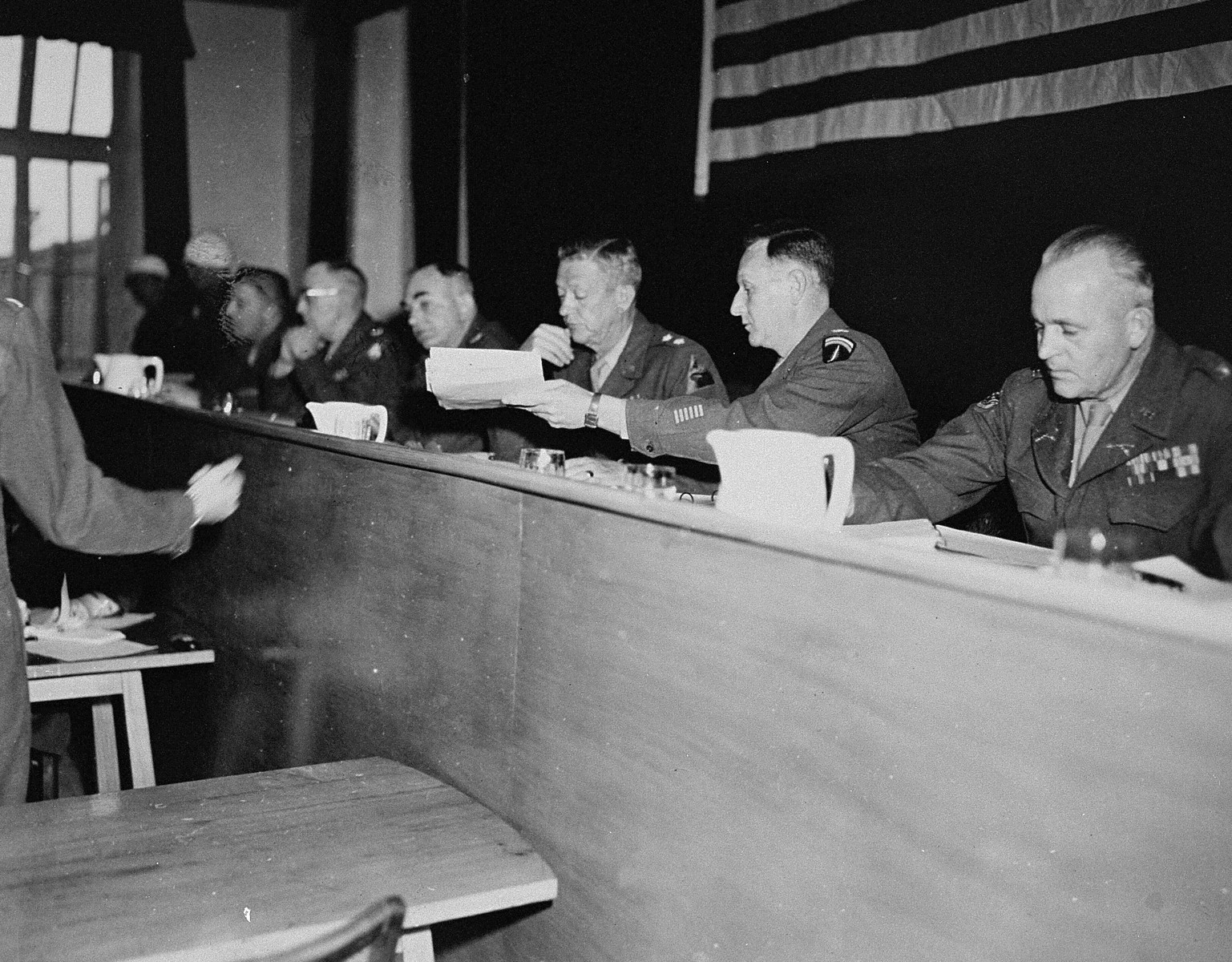 The American Military Tribunal hearing the trial of 61 former camp personnel and prisoners from Mauthausen.  Third from the right is the Tribunal's president, Major General Fay Brink Prickett.