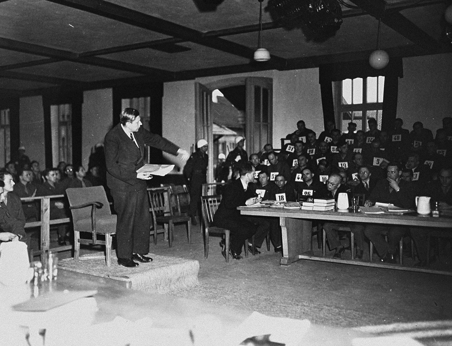 Prof. Dr. Vratislav Busek, a former prisoner at Mauthausen, testifies at the trial of 61 former camp personnel and prisoners from Mauthausen.