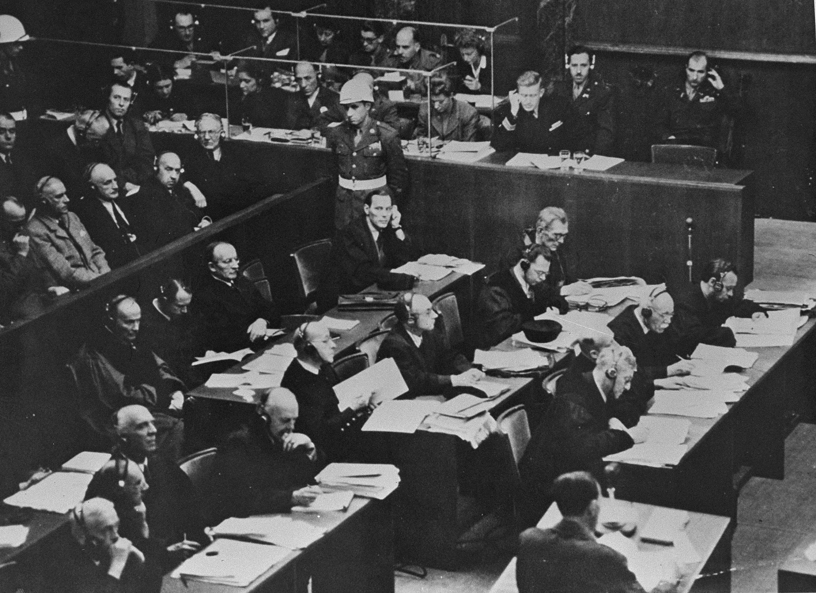 The defendants (left), their lawyers (middle), and interpreters (top) at the International Military Tribunal trial of war criminals at Nuremberg.