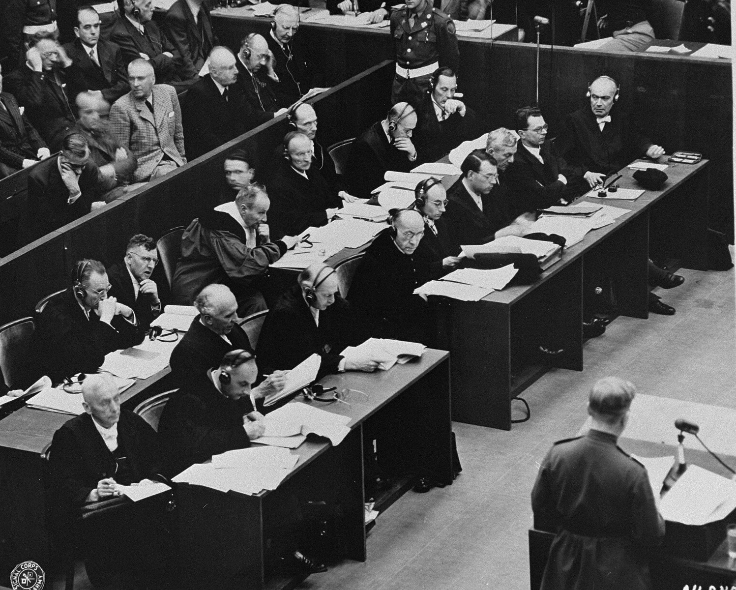 The defense counsellors hear the reading of the indictment against the defendants on the first day of the International Military Tribunal trial of war criminals at Nuremberg.