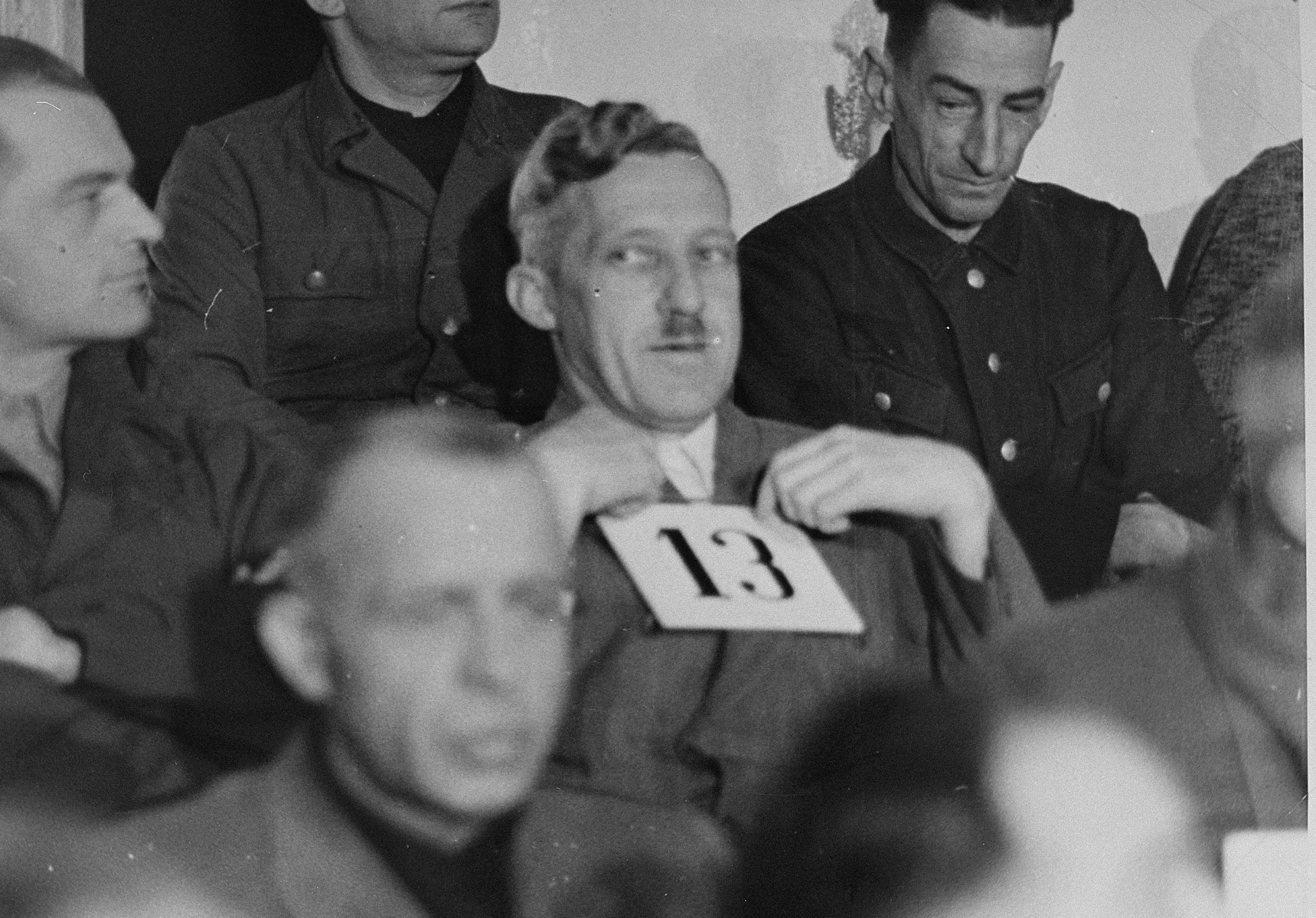 August Eigruber, former Gauleiter of Upper Austria and a defendant at the trial of 61 former camp personnel and prisoners from Mauthausen, sits in his place in the defendants' dock.    Eigruber was convicted and sentenced to death on May 13, 1946.