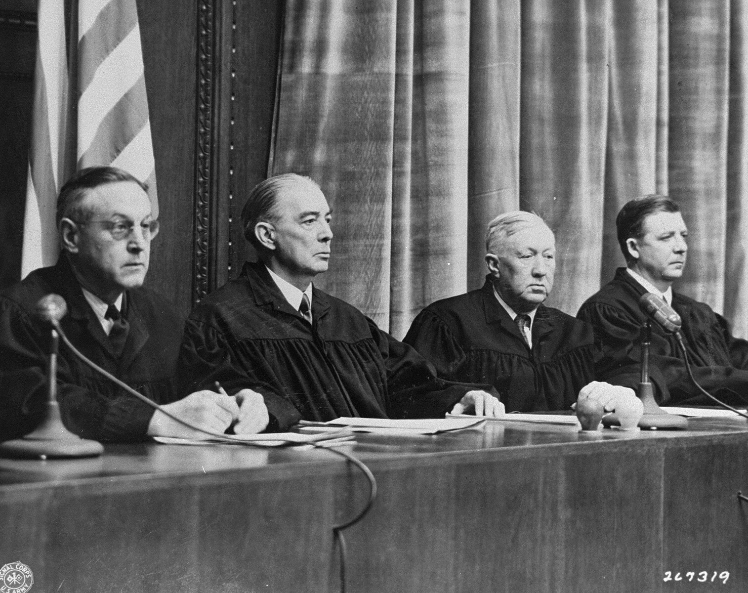 The Military Tribunal I judges hearing the Doctors Trial.  From left to right are Harold L. Sebring, Walter B. Beals, Johnson T. Crawford, and Victor C. Swearingen.