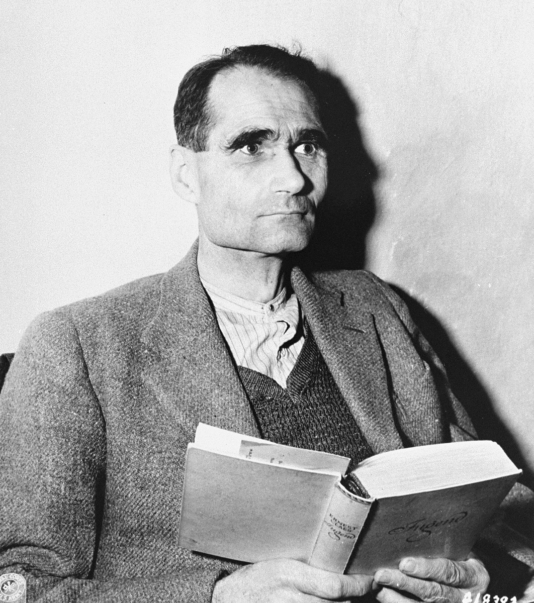 "Defendant Rudolf Hess reads ""Jugend"" by Ernest Glass in his cell at the Nuremberg prison while on trial before the International Military Tribunal."