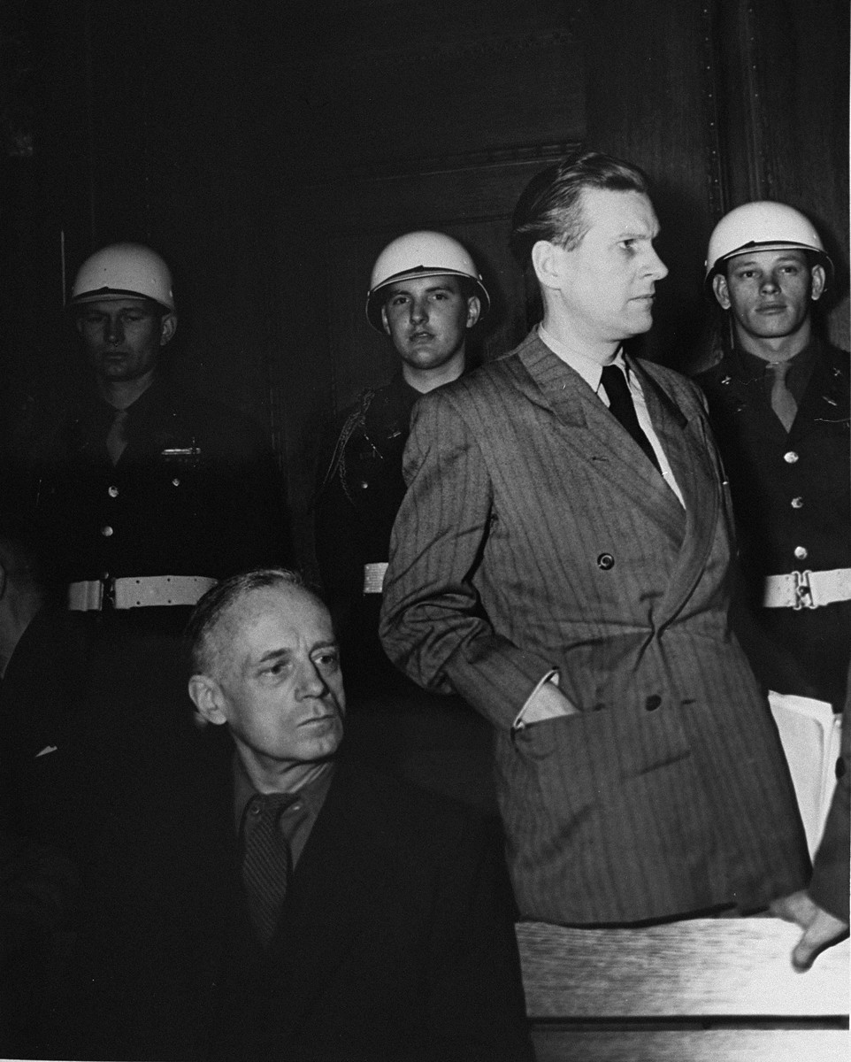 Joachim von Ribbentrop (left), former Foreign Minister, and Baldur von Schirach (right), former leader of the Hitler Youth, during a recess at the International Military Tribunal trial of war criminals at Nuremberg.