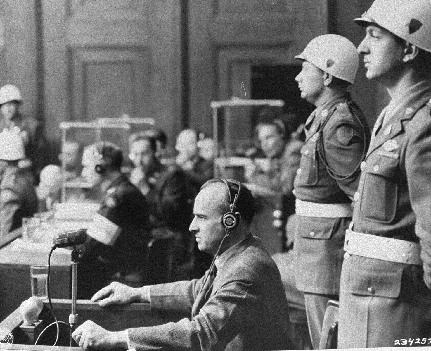 Hans Frank, the former Nazi Governor General of Poland, in the witness box at the International Military Tribunal trial of war criminals at Nuremberg.