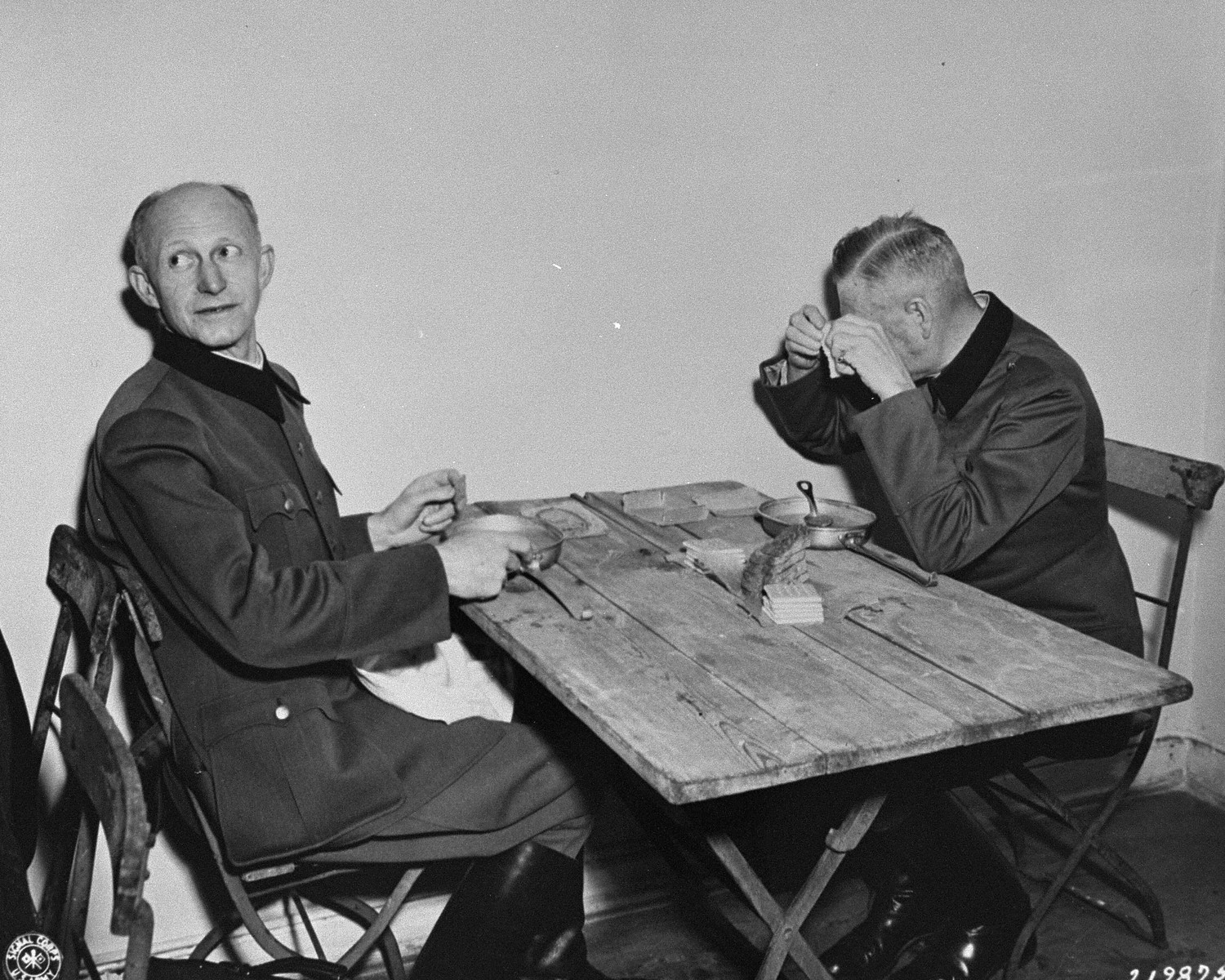 Defendants Alfred Jodl (left) and Wilhelm Keitel (right) eat in a makeshift dining room adjacent to the courtroom at the International Military Tribunal trial of war criminals at Nuremberg.
